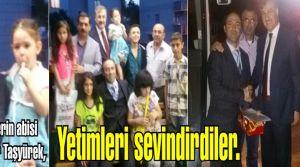 Yetimlerin abisi Abubekir Taşyürek, Muhtar Erhan Gülmüş'le yetimleri sevindirdiler.
